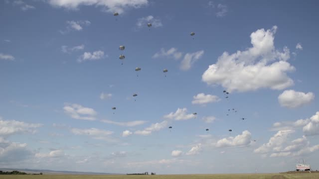 a us air force c130 hercules and romanian air force c130 hercules deliver romanian paratroopers at boboc air base romania during exercise carpathian... - fallschirmjäger stock-videos und b-roll-filmmaterial
