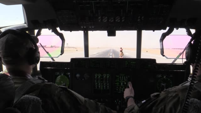 air force c-130j super hercules crew members assigned to the 774th expeditionary airlift squadron transport supplies to various bases after taking... - bagram air base stock-videos und b-roll-filmmaterial