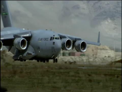 us air force c17 globe master plane taxis along runway at bagram airbase afghanistan july 2002 - bagram stock videos & royalty-free footage