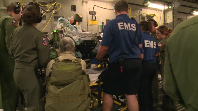 a us air force c17 globemaster iii from the mississippi air national guard's 172nd airlift wing transported six injured children and their guardians... - emt unloading stock videos & royalty-free footage