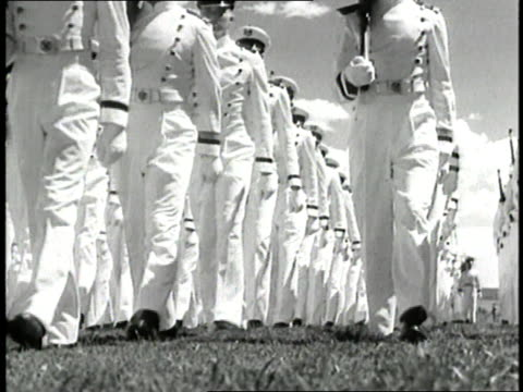 stockvideo's en b-roll-footage met air force cadets in white uniforms march with rifles in formation. - kadet