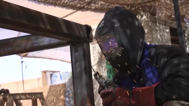 US Air Force civil engineers welding to improve infrastructure on Nigerien Air Base 201 Agadez Niger