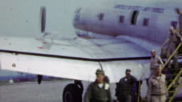 1951: US Air force deplaning from soldiers during Korean War.