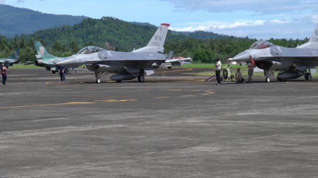 air force f-16c fighting falcons assigned to the 13th expeditionary fighter squadron, 35th fighter wing based out of misawa air base, japan along... - sam west stock videos & royalty-free footage