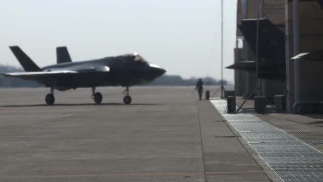us air force f35a lighting ll's arrive at kunsan air base republic of korea in support of vigilant ace 2018 the f35's are currently deployed in... - 米軍点の映像素材/bロール