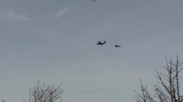 US Air Force flypast over Sheffield to mark 75th anniversary of WWII crash ENGLAND Sheffield Endcliffe Park EXT GROUND to AIR shot of US fighter jets...