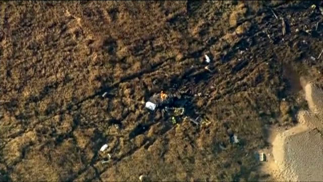 air force helicopter crash in norfolk; england: norfolk: cley-next-the-sea: ext aerial wreckage and debris remains of crashed helicopter on marshland... - g force stock videos & royalty-free footage