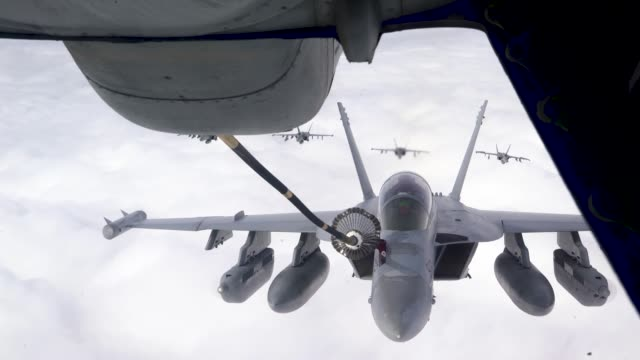A US Air Force KC10 Extender conducts aerial refueling with US Navy F/A18 Super Hornets and EA18 Growlers and a US Air Force B2 Spirit above Joint...