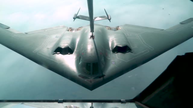 a us air force kc10 extender conducts aerial refueling with us navy f/a18 super hornets and ea18 growlers and a us air force b2 spirit above joint... - bomber plane stock videos & royalty-free footage