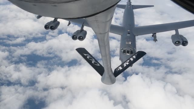 A US Air Force KC135 Stratotanker from Air Refueling Wing at RAF Mildenhall England refuels a B52 Stratofortress above the English coast in support...