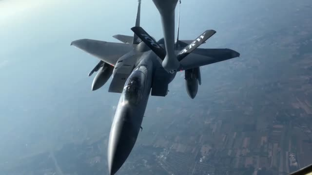 US Air Force KC135 Stratotanker from the 100th Air Refueling Wing refuels F16 Fighting Falcons and F15 Eagles US Air Force recently conducted...