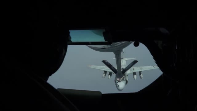 A US Air Force KC135 Stratotanker refuel US Marine Corp EA6B Prowler assigned to Marine Tactical Electronic Warfare Squadron 2 over Iraq in support...