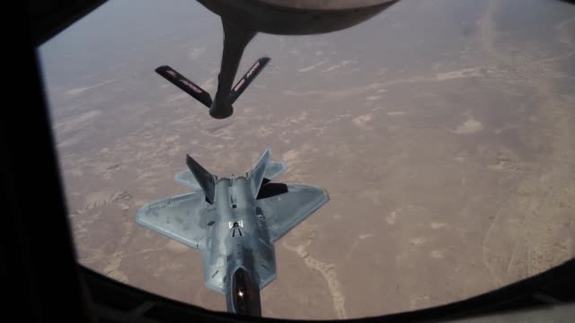 air force kc-135 stratotanker refuels f-22 raptors from joint base langley-eustis, virginia currently deployed to al udeid air base, qatar. - us airforce stock videos & royalty-free footage
