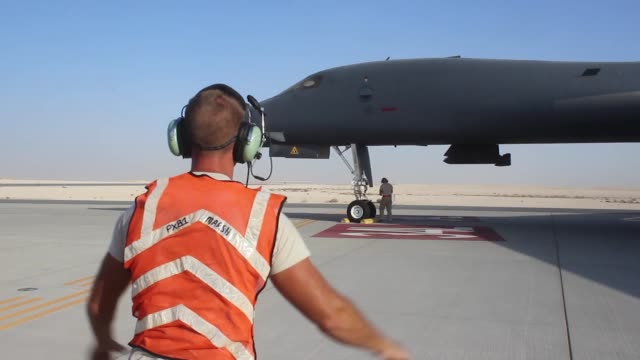 US Air Force maintainers from Ellsworth Air Force Base South Dakota service and inspect the B1B Lancer The maintainers are within the 379th Air...