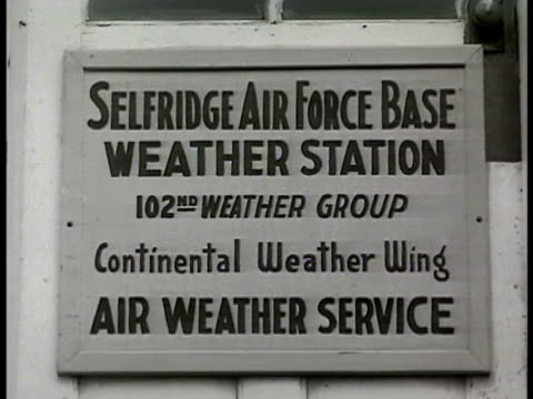 vídeos de stock, filmes e b-roll de air force male into building door sign selfridge afb weather station 102 weather group contiental weather wing air weather service int officer... - 1948