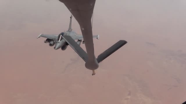 US Air Force members from the 340th EARS gives preform aerial refueling To French Rafaels and USMC EA6B Prowlers over an undisclosed location on July...