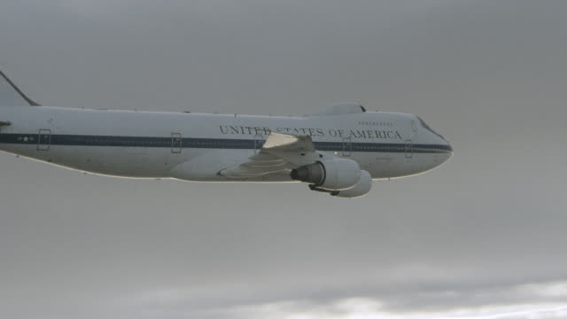 air force one flies amid the clouds. - air force one stock videos & royalty-free footage