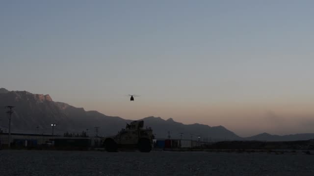 air force pararescue airmen from the 83rd expeditionary rescue squadron at bagram airfield, afghanistan conduct hoist training nov. 1, 2018. - bagram air base stock-videos und b-roll-filmmaterial