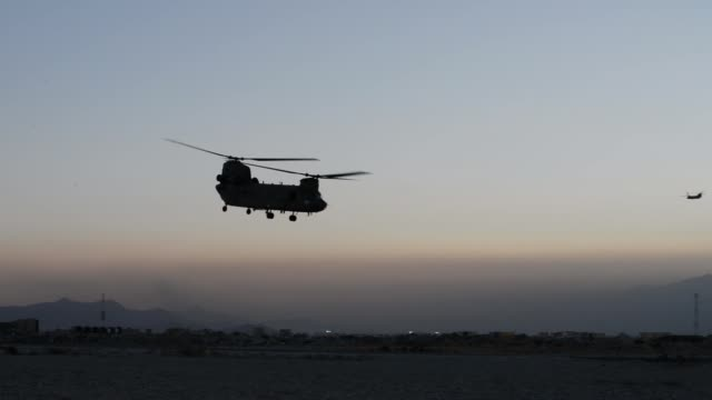 air force pararescue airmen from the 83rd expeditionary rescue squadron at bagram airfield, afghanistan conduct hoist training nov. 1, 2018. - bagram stock videos & royalty-free footage