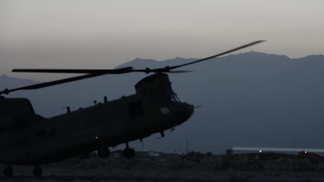air force pararescue airmen from the 83rd expeditionary rescue squadron at bagram airfield, afghanistan conduct hoist training nov. 1, 2018. - bagram stock-videos und b-roll-filmmaterial