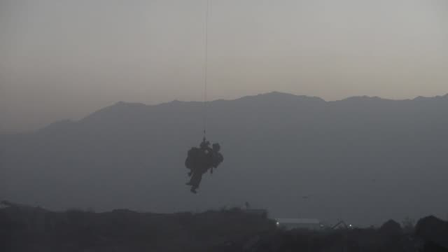 air force pararescue airmen with the 83rd expeditionary rescue squadron conduct in-flight medical training at bagram airfield, afghanistan. - bagram air base stock-videos und b-roll-filmmaterial