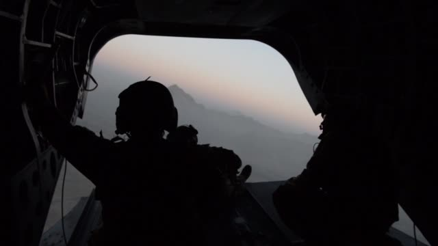 air force pararescue airmen with the 83rd expeditionary rescue squadron conduct in-flight medical training at bagram airfield, afghanistan. - bagram stock-videos und b-roll-filmmaterial