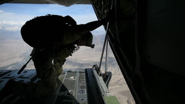 air force pararescuemen assigned to the 83rd expeditionary rescue squadron at bagram airfield, afghanistan, conduct a training jump out of a 774th... - 円光点の映像素材/bロール