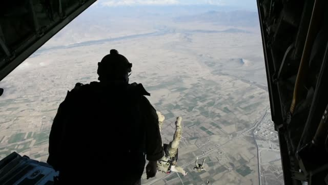 us air force pararescuemen assigned to the 83rd expeditionary rescue squadron at bagram airfield afghanistan conduct a training jump out of a 774th... - military airplane stock videos & royalty-free footage
