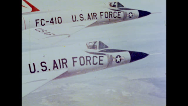 1964 U.S. Air Force planes soar through the sky