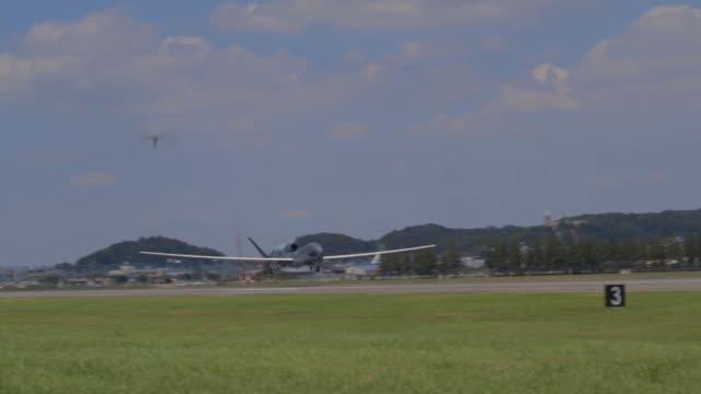 us air force rq4 global hawk arrives at yokota air base japan from andersen air base guam 5 august 2019 - remote control stock videos & royalty-free footage