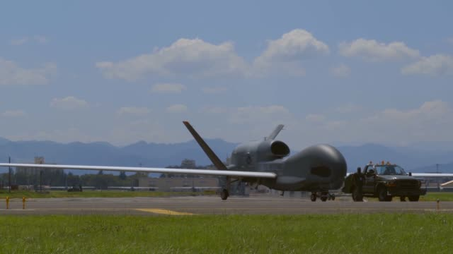 air force rq-4 global hawk arrives at yokota air base, japan from andersen air base, guam, 5 august 2019. - グアム点の映像素材/bロール