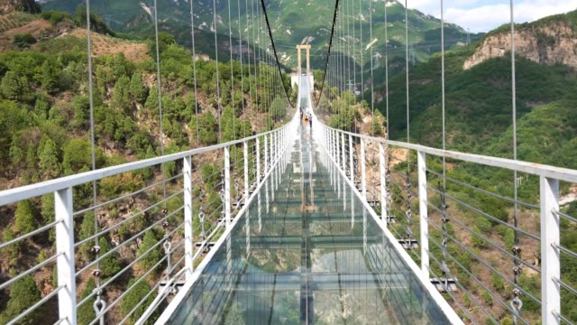 air glass suspension bridge between mountains - footbridge stock videos & royalty-free footage
