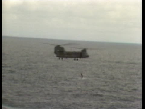 air india crash off eire a/sea helicopters hovering above sea a/sea ship searching a/sea chinook helicopter hovering as member of search team... - military helicopter stock videos & royalty-free footage