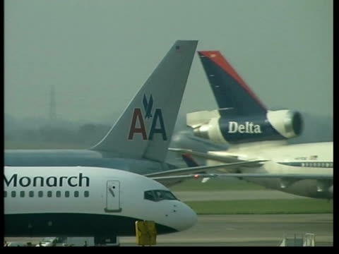 air passengers delayed after computer crash itn airplane tail fins as planes taxi pan to plane taking off pan - airplane tail stock videos and b-roll footage