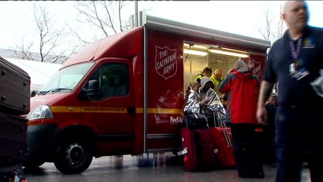 air passengers queuing to enter departure hall salvation army van giving out hot drinks to delayed passengers couple waiting wrapped in foil survival... - salvation army stock videos & royalty-free footage