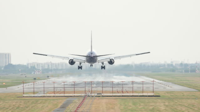 air plane landing on runway - landing touching down stock videos & royalty-free footage