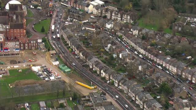 coroner rules air pollution contributed to death of ella kissi-debrah; england: london: lewisham: ext air view / aerial traffic along south circular... - circle stock videos & royalty-free footage