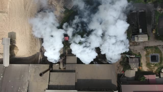 air pollution from factory, aerial shot - smoke stack stock videos & royalty-free footage