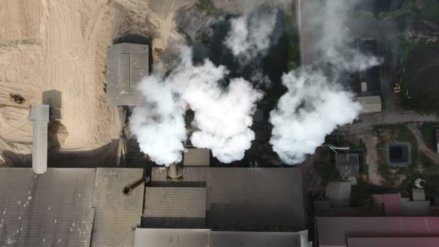 air pollution from factory, aerial shot - cooling tower stock videos & royalty-free footage