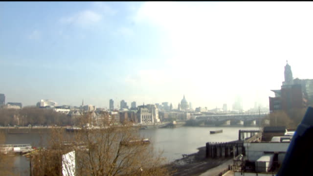 Can Britain learn lessons from China on protecting the public ENGLAND London View down the River Thames towards St Paul's Cathedral showing haze from...