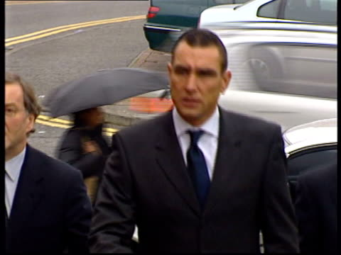 vinnie jones sentenced for assault; lnn - no resale. england: london: ext cms actor and former footballer vinnie jones from court after being... - vinnie jones stock videos & royalty-free footage