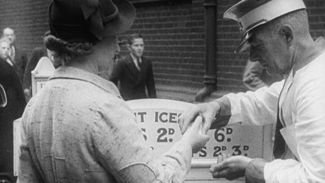 montage air raid alert in the city, with residents running for the bomb shelters, police blowing whistles, and klaxon howling during world war ii / united kingdom - anno 1939 video stock e b–roll