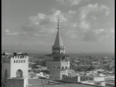 air raid siren on muslim minarets capitol city tunis. french & arabic air raid precaution sign. sirens on minaret. wwii - air raid siren stock videos & royalty-free footage