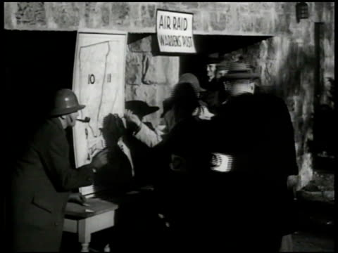 stockvideo's en b-roll-footage met air raid wardens lined up for directions ms wardens checking hanging map int ms nurse w/ blood donor patients laying on hospital beds cu blood into... - 1941