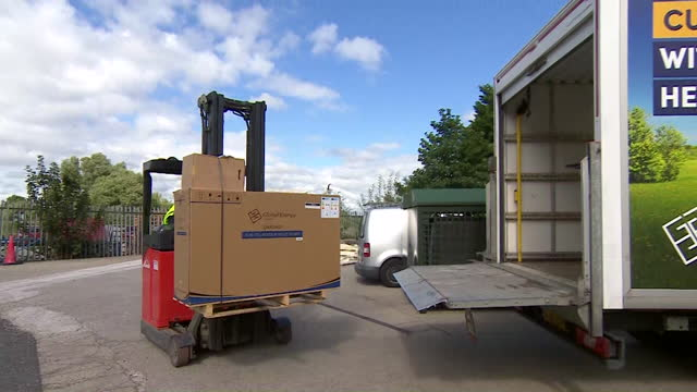 air source heat pumps being made and loaded onto van at global energy systems factory in lytham st annes, lancashire - リザムセントアンズ点の映像素材/bロール