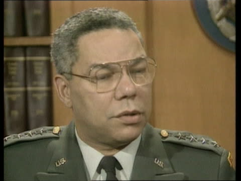 Powell interview ITN USA Washington Pentagon General Colin Powell toward in corridor with other official PAN RL CMS Powell shaking hands with Trevor...