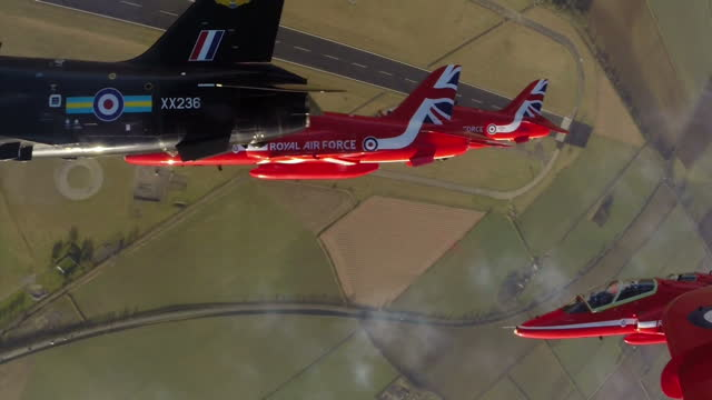 air to air point of view cockpit shots raf red arrows hawks performing aerobatics flying in formation at raf scampton on february 25 2015 in scampton... - military aeroplane stock videos & royalty-free footage