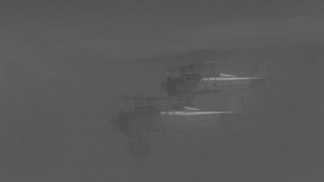 ms aerial air to air shot of couple of biplanes flying in sky - air to air shot stock videos & royalty-free footage