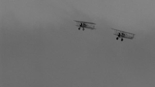 ws aerial ts air to air shot of couple of biplanes flying in sky - air to air shot stock videos & royalty-free footage