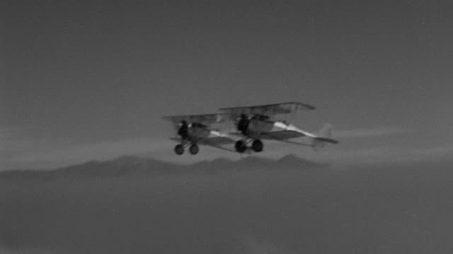 ms aerial ts air to air shot of couple of biplanes flying in sky - air to air shot stock videos & royalty-free footage
